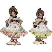 A pair of Vintage Germany Porcelain Dresden Lace Girl Figurines.