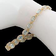 "14K Gold Blue Topaz Tennis Bracelet 8"""