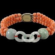 SOLD Carved Jade and 3 Strand Coral Bracelet
