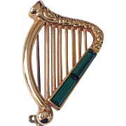 SOLD Gold Tone Celtic Harp Pin With Emerald Rhinestone Baguettes