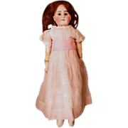 """SALE 20"""" German Belton style doll with closed mouth on a kidolene body"""