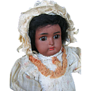 Kammer & Reinhardt W  mulatte antique doll  16 inches or  40 cm.