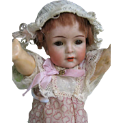 Kammer & Reinhardt 126 girl 8 1/2 inches or 22 cm with spread hands.