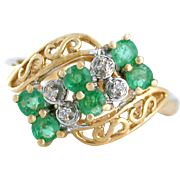 1950s Emerald and Diamond Ring with Gold Filigree set at an angle. 10k yellow gold.