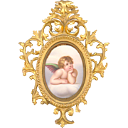 Excellent Hand Painted Porcelain Plaque of a Cherub framed in a Sweet Gold Gilt Frame ...