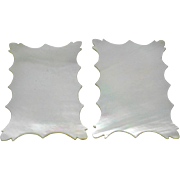 A pair of mother of pearl thread winders.