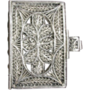 A Georgian silver filigree miniature book cover. c 1800