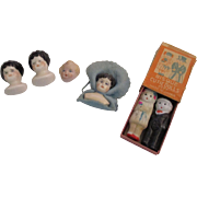 Assortment of miniature porcelain German doll heads