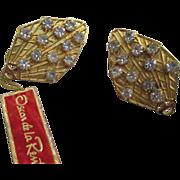 Collectable Oscar de la Renta clamp earrings hang tag