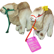 Pair of Steiff Camels, different colored reins.