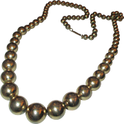 Early 1950's statement getter large gold wash ball necklace
