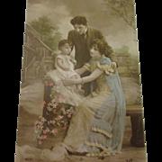 Beautiful hand tinted photo of family Art Noveau
