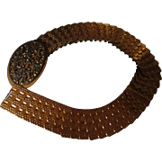Vintage 1960's Copper Snake scales elastic belt. For a Woman