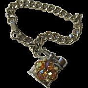 Vintage new stock 1960 real lighter charm bracelet.  ( Christmas stocking stuffer )