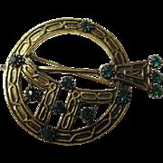 Unique symbolic Celtic brooch