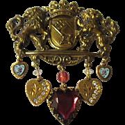Unusual vintage brass charm brooch English Crest.
