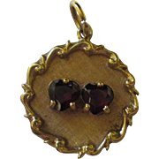 Beautiful valentines 14k yellow gold pendant with two garnets.