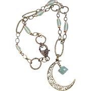A Man in the Moon Brass Pendant with a Green Aventurine Nugget Brass Necklace