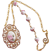 A Porcelain Rose and Metal Pendant and Porcelain Rose Bead Necklace
