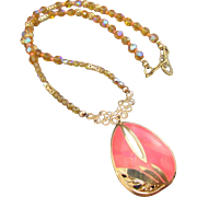 An Enameled Coral Teardrop Pendant and Crystal Necklace and Earrings