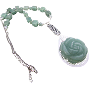 A Green Aventurine Flower Pendant and Gemstone Necklace and Earrings