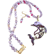 A Brass Rhinestone Studded Dolphin Pendant and Amethyst Gemstone Necklace and Earrings