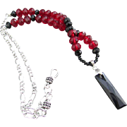 A Swarovski Faceted Crystal Black Pendant and Red Crystal Necklace and Earrings