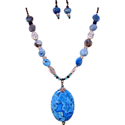 A Blue Crazy Lace Agate Oval Pendant Necklace and Earrings