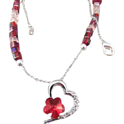 A Heart with Austrian Crystal Pendant and Red and Pink Glass Beads Necklace and Earrings