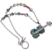 An Abalone Enameled Guitar and Abalone Necklace and Earrings