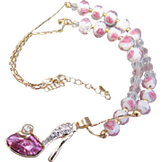 An Austrian Crystal Studded Slipper and Faceted Glass with Pink Flower Necklace and Earrings