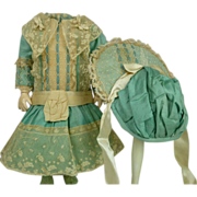 Gorgeous French turquoise satin and lace dolls dress with matching bonnet