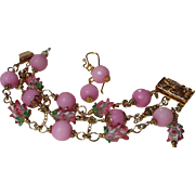 Pretty Pink And Gold Colored Bracelet With Matching Earrings