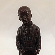 "SOLD A German Bronze Figure of a Young Boy Holding His Hat, Signed 'H. Gebhardt"" and """