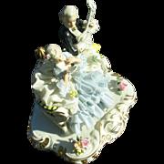 Group Dresden Lacey Figural Porcelain Gentleman W/ Guitar & Woman Singing To Sheet Music.