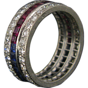 An original and unique Tricolour Eternity ring with sapphire, ruby and diamond