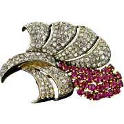 A notable flower brooch with diamonds and synthetics rubies
