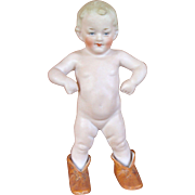 """Small Heubach Figurine """"Wearing Mommy's Shoes"""""""