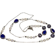 A Sapphire and Baroque Pearl Rope Necklace set in Silver