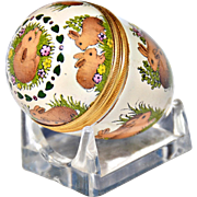 SOLD Halcyon Days' Hand-Painted Enamel Egg with Bunnies on Clear Plastic Cradle