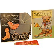 Three near mint paper doll books Baby Nancy, Victorian Pets and Santa Claus