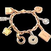 An Authentic CARTIER 18K Gold Charm Bracelet Box Authenticity Papers