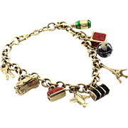 Rolo Link Charm Bracelet with 9 Enamel Travel Charms in 14K Yellow Gold