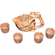Intricately hand carved Jichimu wood tea pot and 4 small cups