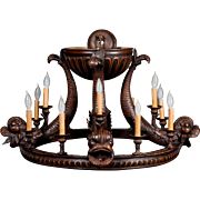 An Art Deco carved wood Chandelier ceiling fixture, circa 1935.
