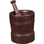 An interesting mortar and pestle, early 19th century made of Lignum Vitae, has a possible ...