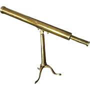 SOLD An English 19th century brass telescope on stand.