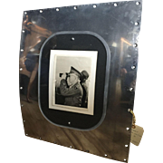 WW ll photo of General Dwight D.Eisenhower set into a piece of aircraft fuselage.