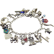 British Sterling Silver Charm Bracelet with Heart Padlock Clasp and 20 Charms Attached