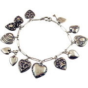 Vintage Sterling Silver Bracelet with Puffy Heart Charms